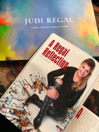 Artist Judi Regal and her new coffee table book of her recent exhibition.