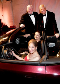 CZS pres/CEO Dr. Stuart Strahl; CZS board chair John Grube; CZS WB president Sasha Gerritson and CZS WB member and 2018 Whirl chair Elisa Templeton pictured with a 2019 Aston Martin DB11 provided by Aston Martin Glenview