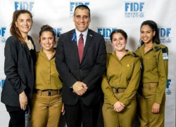 Consul General of Israel to the Midwestern US Aviv Ezra (center) and his wife Enat with IDF soldiers (Photo by Jeff Ellis).