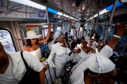 An el train filled with partygoers