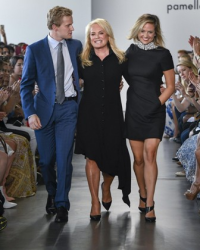 Pamella Roland, flanked by her darling family, takes her runway bow