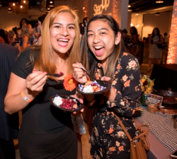 Step-Up alumnae Priscilla Ramos and Camille Adao enjoy one of the event's 25 tasting stations