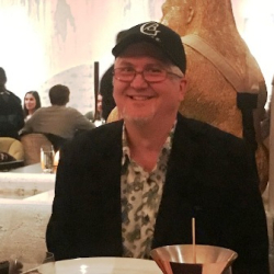 Rob Walton wearing a take-home baseball cap from the slider entree