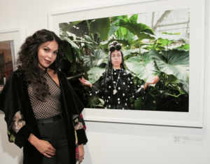 Singer/songwriter Kiara Lanier in front of her enigmatic photo