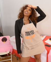 """Charmaine Johnise (""""Black Ink Chicago"""") in one of her bestselling aprons."""