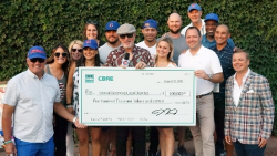 CBRE Charity Bash check presentation with Ryne Sandberg, Kyle Schwarber, Joe Maddon, Wilson Contreras, Jon Lester, Andre Dawson and friends.