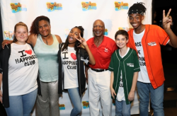 Artistic director Tanji Harper with Jesse White and The Happiness Club Kids