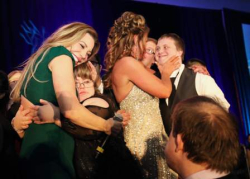 Taylor Dayne, Nancy Gianni with gala attendees with Down syndrome