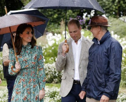 The Duke and Duchess of Cambridge pay tribute to Princess Diana with Graham Dillamore (R).
