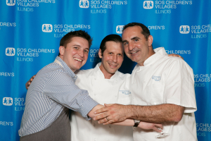 Chefs enjoying themselves in front of step and repeat