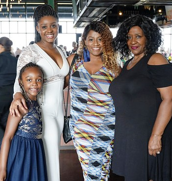 Lisa Cox  VP of Marketing  in blue   Tallest one is Jaelah Steele  the younger is Kennedy Ali