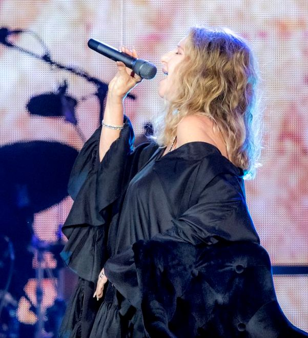 Barbra Streisand performs in London on July 7  2019  wearing a black gown by Azeeza. (Dave J. HoganGettyDave J HoganGetty Images for Ba)