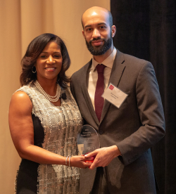Brian Haynes  I-NOMA accepts Community Partner Award from Dara Munson