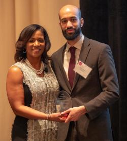 Brian Haynes  I-NOMA accepts Community Partner Award from Dara Munson