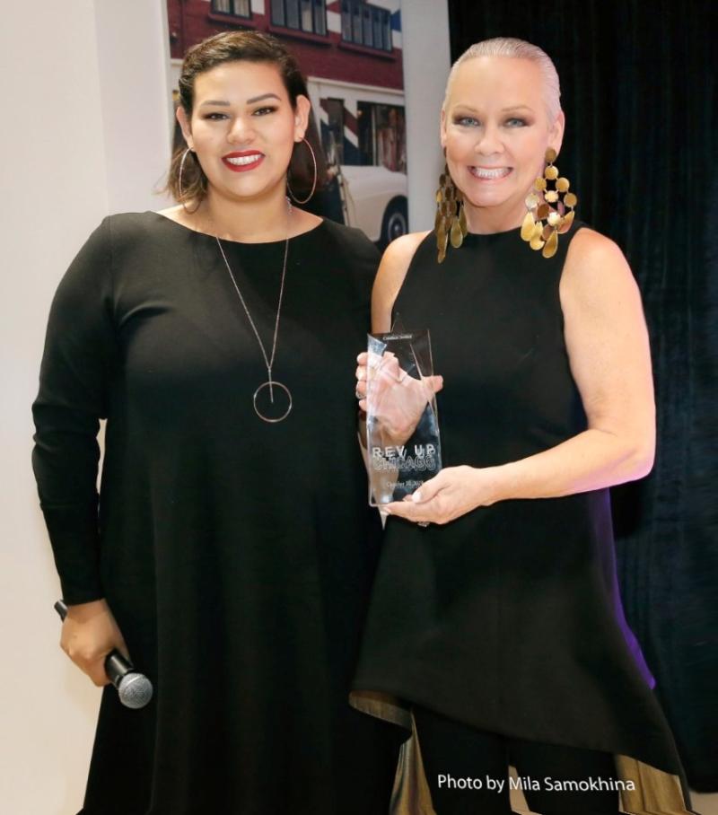 AIBI executive director Ambar Campos presents Candace Jordan with her award at Rev Up! 2019.