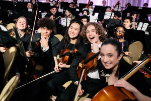 CYSO students sharing a laugh before the performance  - Photo Credit Kyle Flubacker