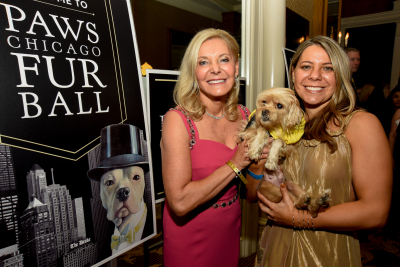 Paula Fasseas with Alexis Fasseas and PAWS dog Loretta.