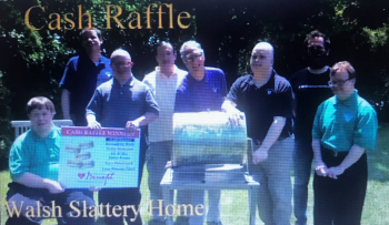 Residents from Misericordia's Walsh Slattery Home help with a raffle.
