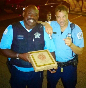 Chase Garrett  (R) a retired 32-year vet of the Chicago PD with friend.