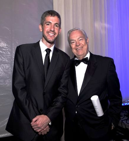 Kevin Byrne with the evening's auctioneer, Bill Kurtis